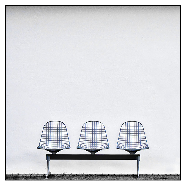 3 chairs and a wall
