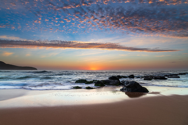 Beautiful sunrise with high cloud at the seaside