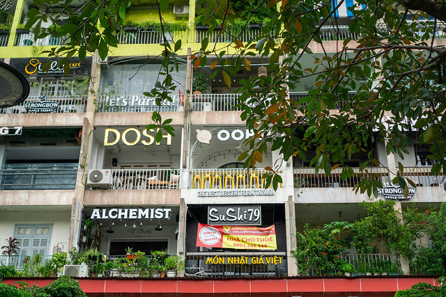 Close Up Photo of Cafes and Restaurants of The Cafe Apartment Building in the City Center of Saigon, Vietnam