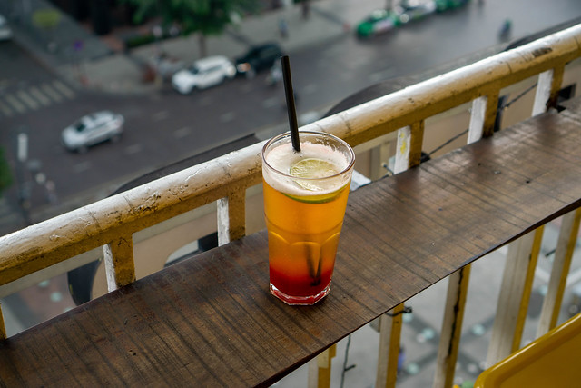 Strawberry Flavored Beer with Slice of Lime and Plastic Straw on a Balcony of The Cafe Apartment in Ho Chi Minh City, Vietnam