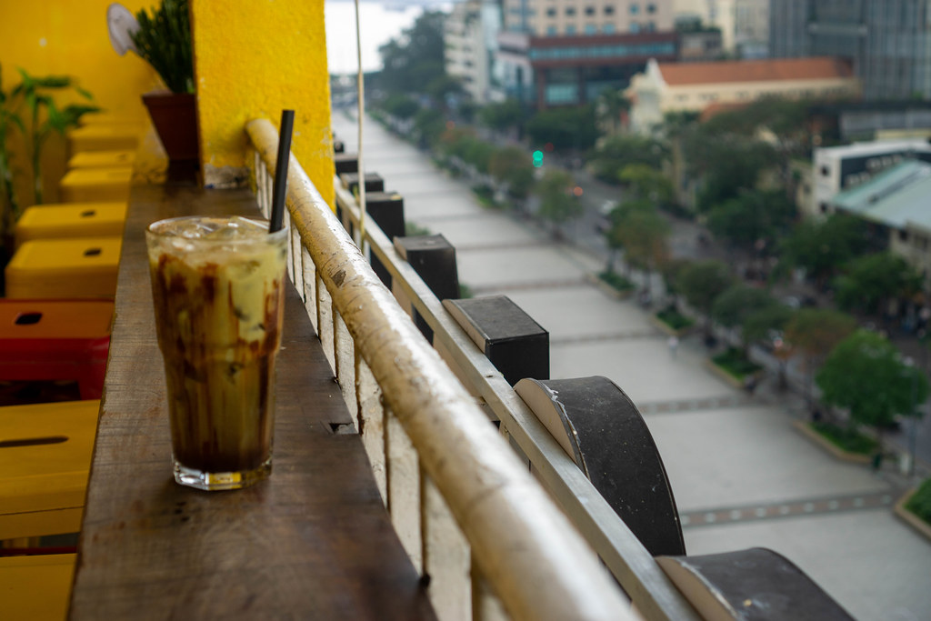 Cold Chocolate Drink with Ice Cubes in a Cocktail Glass on the Balcony of a Coffee Shop at The Cafe Apartment Building in Saigon, Vietnam