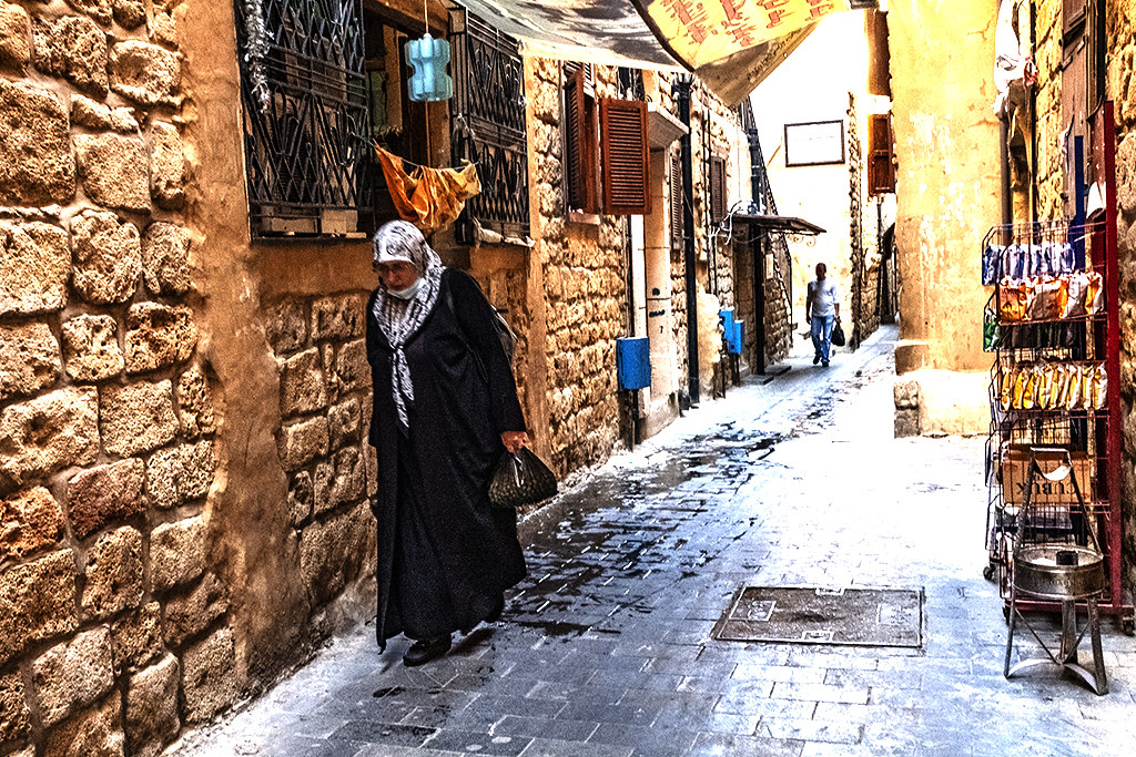 Old woman and man in souq on 11-13-20--Sidon