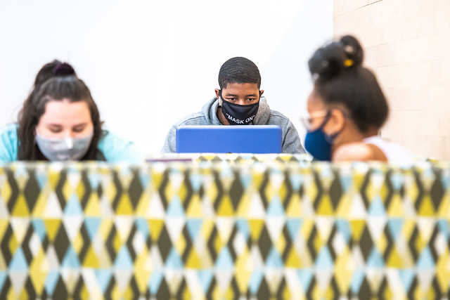 Students studying while wearing masks