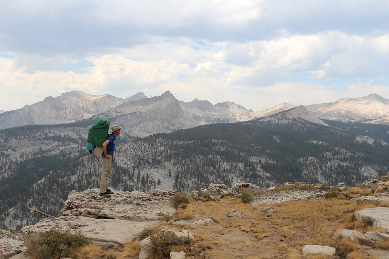 Me. posing with my big backpack (and rain cover) looking out over Big Arroyo on the High Sierra Trail