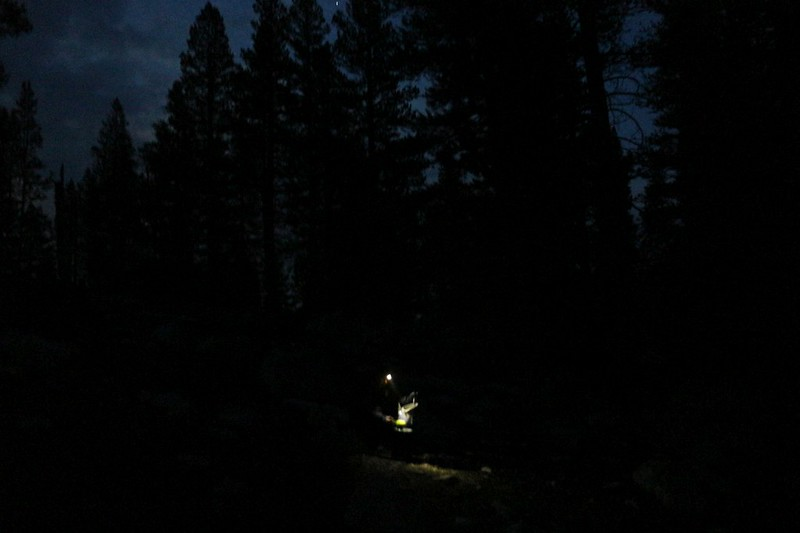 Vicki doing some final packing by headlamp as we prepare to leave Moraine Lake before dawn
