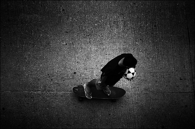 skate in the foot and ball in hand