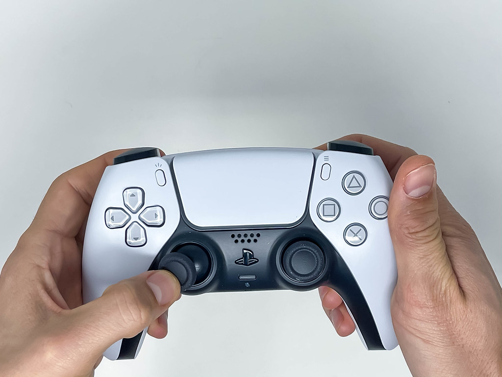 Person holding and using the Joystick of the new Sony Play… | Flickr