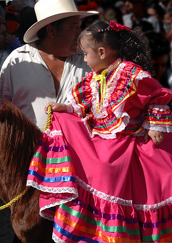 A little girl on a horse for the November 20 Parade for the Day of the Revolution in Ajijic, Mexico