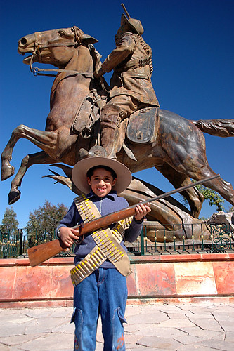 This little revolutionary stands in front of a Pancho Villa rides in on a galloping horse. The statue commemorates the battle that took place on the Cinco de Mayo up on the La Bufa above Zacatecas, Mexico