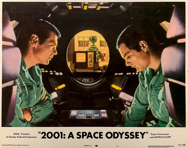 """""""2001 A Space Odyssey"""" (MGM, 1968).  Bowman (Keir Dullea) & Poole (Gary Lockwood) agree to disconnect HAL.  HAL follows their conversation by lip reading.  Original U.S. Lobby Card No. 7 (1972 Re-release)."""