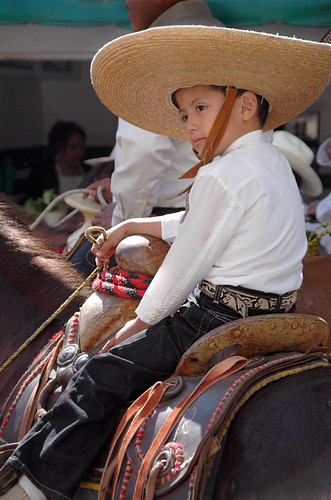 Little boy in a big sombrero riding a horse for the November 20 Parade for the Day of the Revolution in Ajijic, Mexico