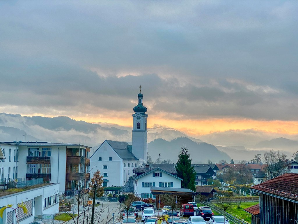 Oberaudorf with church and autumn fog in Bavaria, Germany