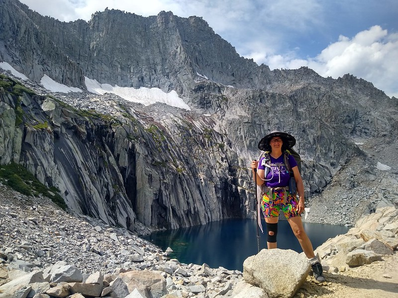 Vicki posing in front of Precipice Lake and Eagle Scout Peak on the High Sierra Trail