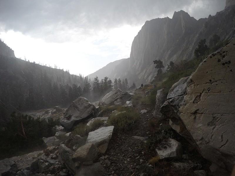 Heavy rain, hail, and wind wet the boulders and created misty spray on the High Sierra Trail near Upper Hamilton Lake