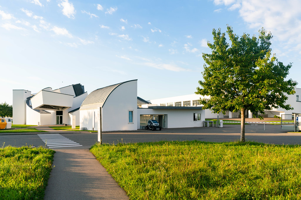 Checkpoint on Vitra museum campus with security guard's EV charging next to it