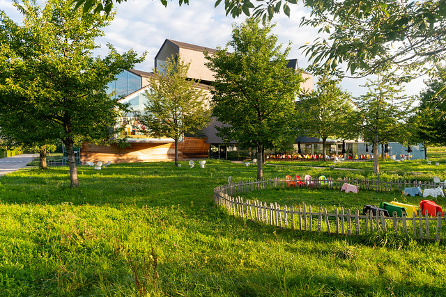 Children playground and garden on Vitra museum campus with VitraHaus in the background
