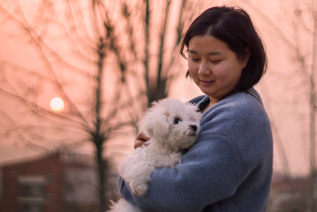 A Chinese woman with her puppy...