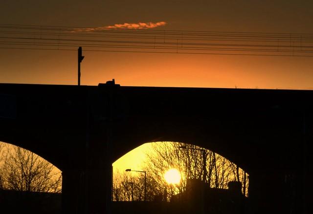 Sunset under the railway bridge at Preston