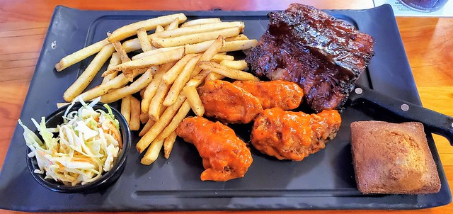 Ribs and wings sampler, with French fries, cornbread muffin, coleslaw
