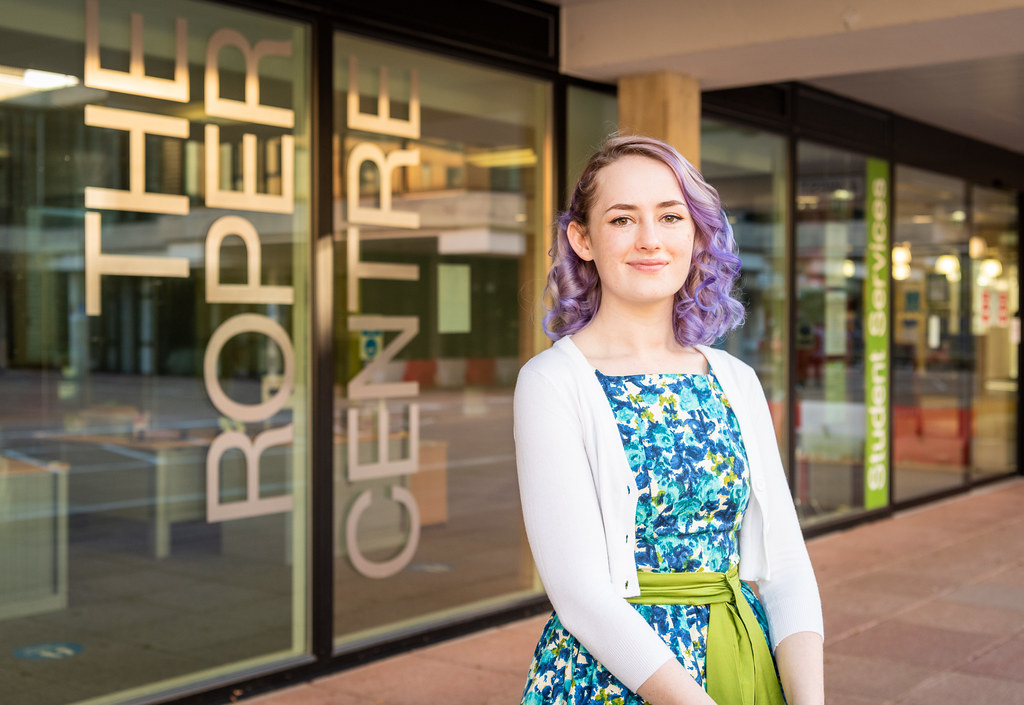 Amber standing outside the Roper Centre on campus.