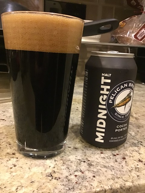 Porter in glass, on kitchen counter, with can of ale
