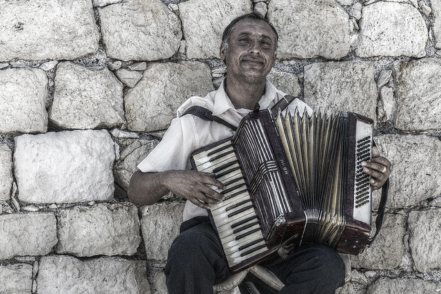 and the accordion played