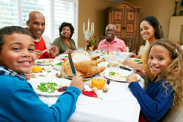 A family sitting down to Thanksgiving
