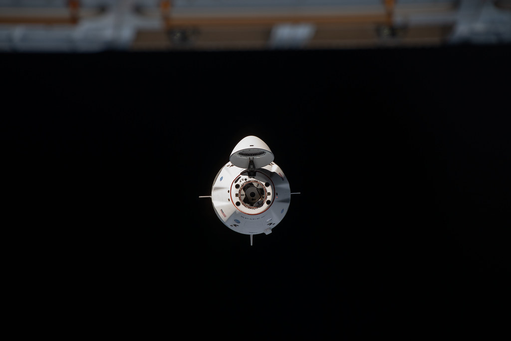 The SpaceX Crew Dragon approaches the space station