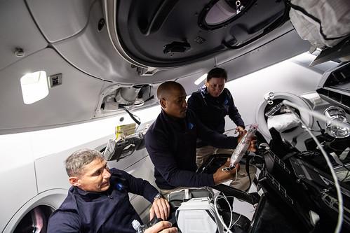 NASA astronauts work aboard the SpaceX Crew Dragon