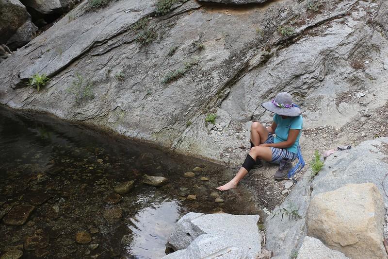 Vicki soaking and cooling off her feet in Nine Mile Creek on the High Sierra Trail