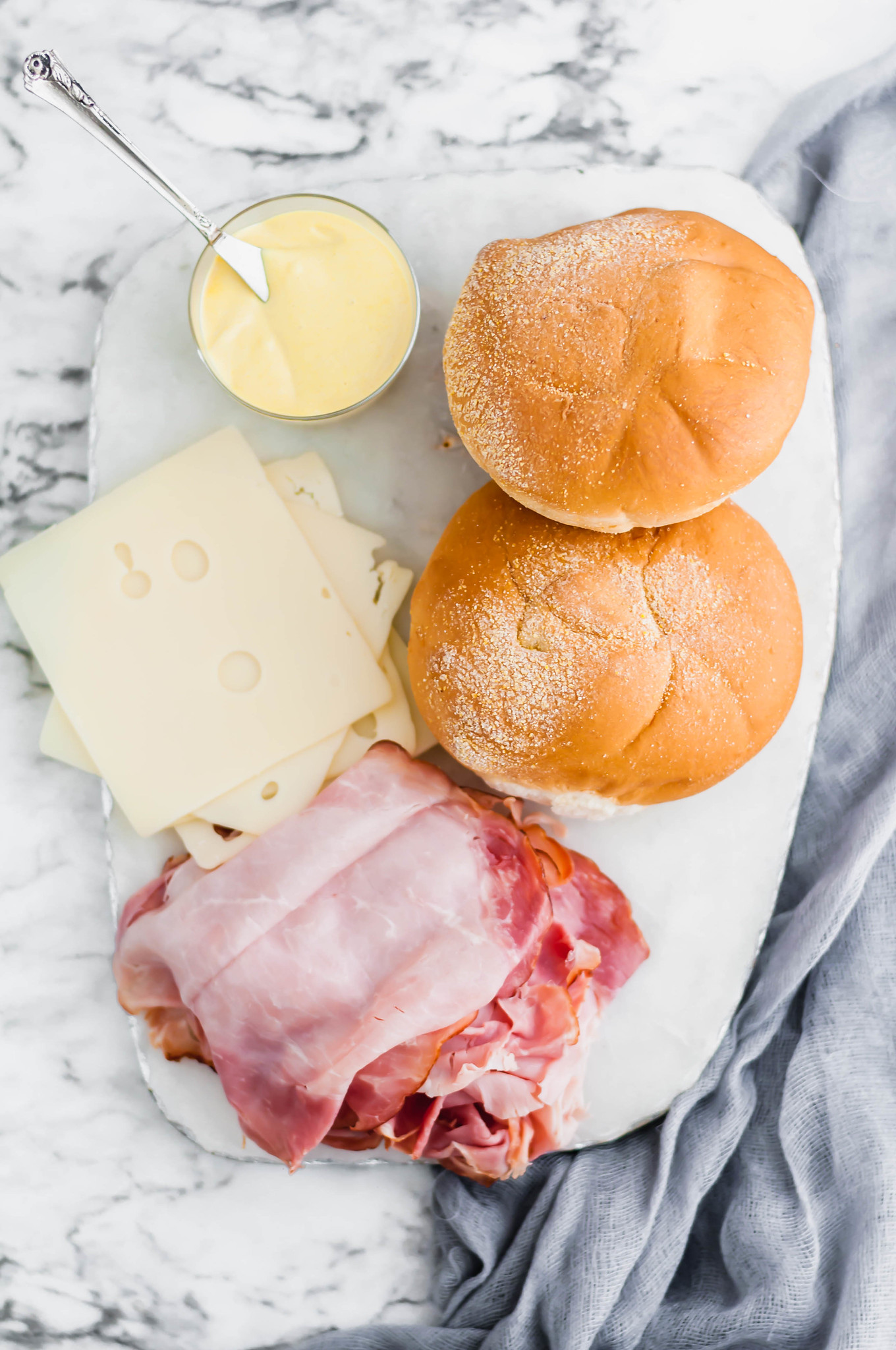 Need an easy lunch or weeknight meal? These Hot Ham and Cheese Sandwiches are the perfect solution. Shaved deli ham (honey ham is my favorite) with melted swiss cheese and a yummy sauce.