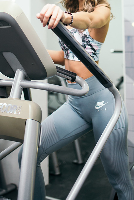 Close-up of a fit woman in the gym, exercising legs doing cardio workout.
