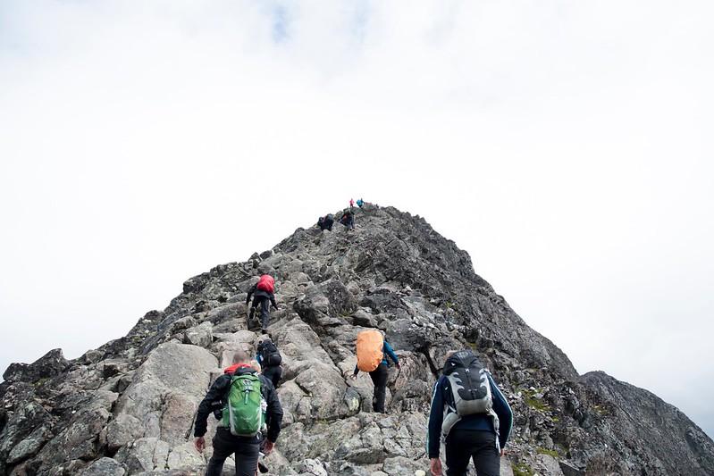 Persons climbing a mountain.