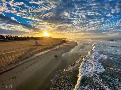 outside beach clouds sunrise ocean sky sand surf huntingtonbeach california blue light sun sea