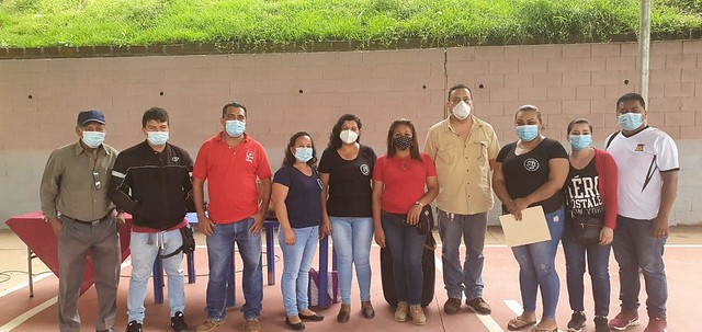 SITRASACOSI Leaders stand with Union League staff, masked, after having distributed support to workers in Nejapa, El Salvador affected by the devastating landslide