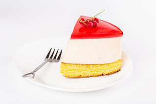 Delicious cheesecake with sponge cake and raspberry jelly