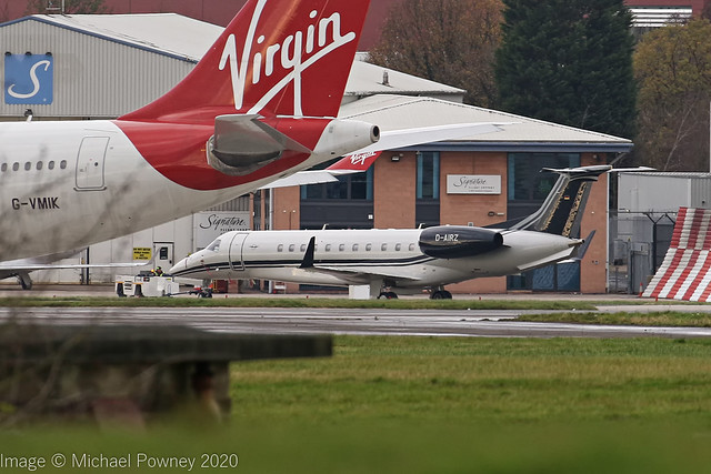 D-AIRZ - 2019 build Embraer 135BJ Legacy 650, under tow on the Signature apron at Manchester