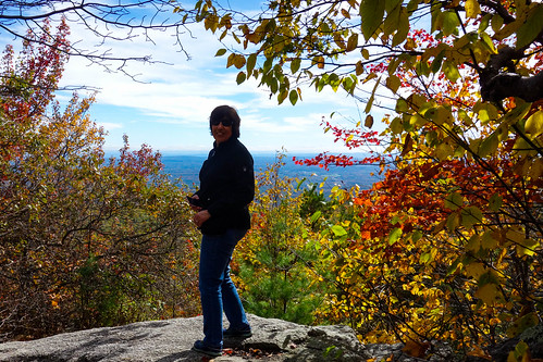 lakeminnewaska newyork blue clouds colors fall green red rock sky view woman yellow
