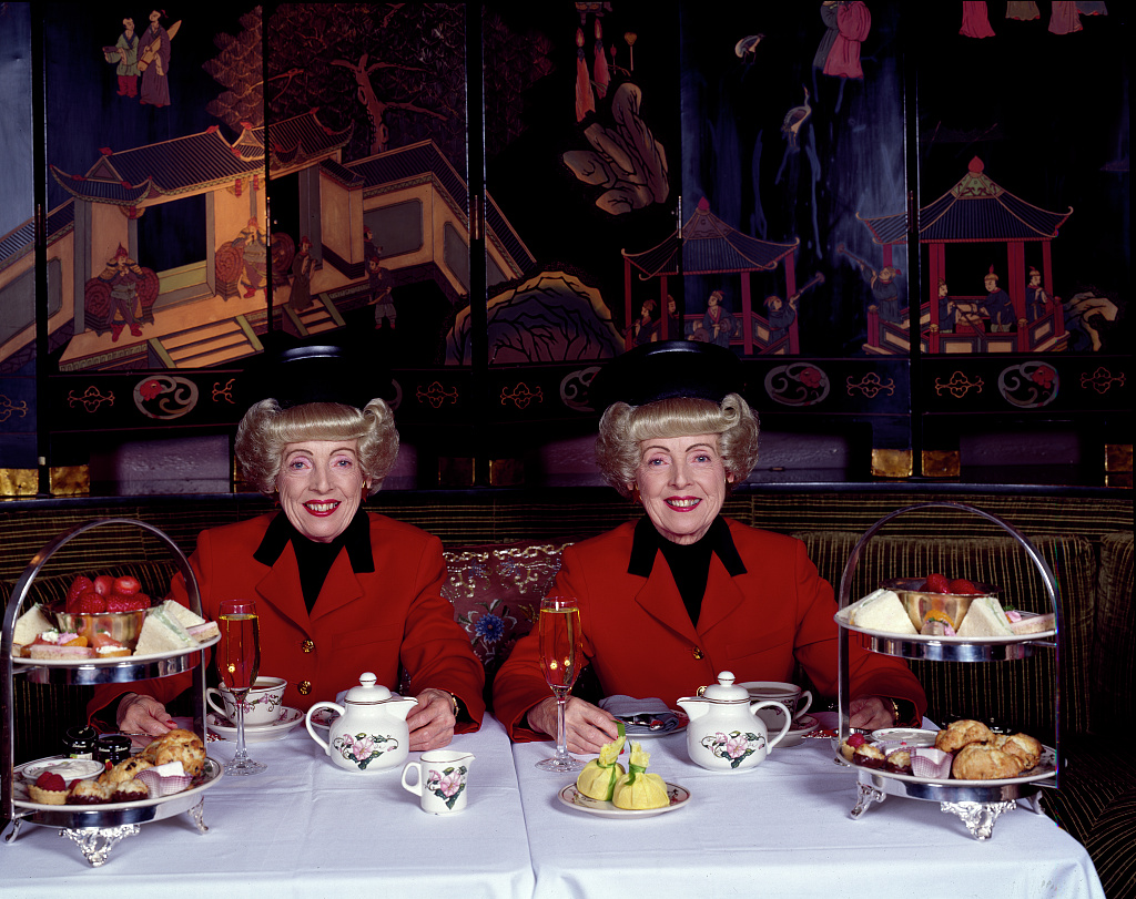 San Francisco, California's most famous twins, Marian (left) and Vivian Brown, photographed in the 1990s, enjoy afternoon tea (LOC)