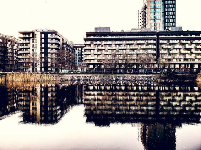 Reflecting buildings on canal (Griffintown, Montreal)