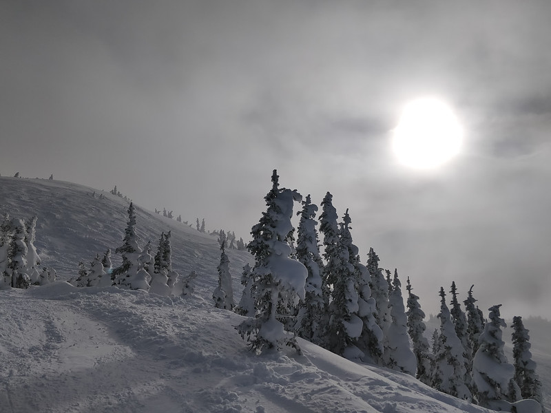 Sun, clouds and powder snow