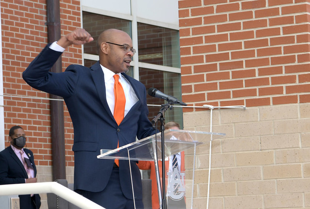 Harold D. Melton waves his fist while doing the War Eagle cheer.