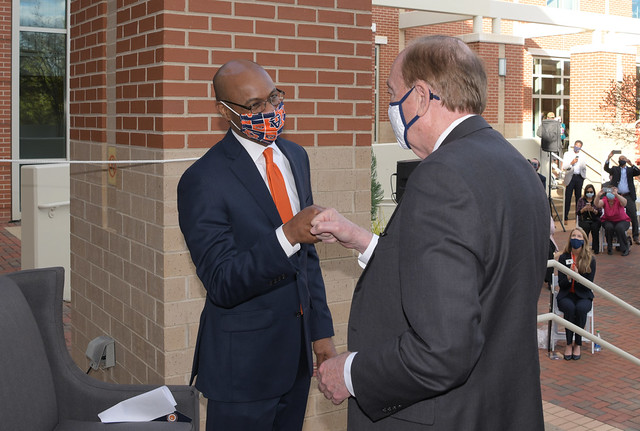 Harold D. Melton and Auburn President Jay Gogue fist-bump
