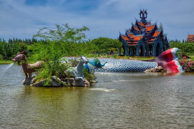 Mount Sumeru and animal sculpture fountains in a lake in Muang Boran (Ancient City) open air museum in Samut Phrakan near Bangkok, Thailand