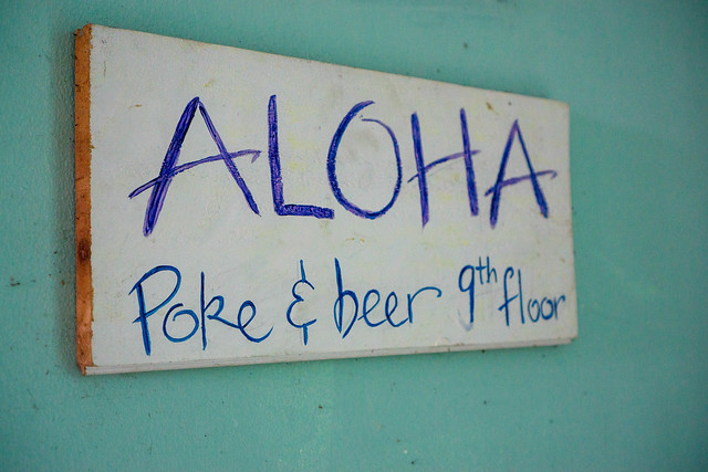 Wooden Sign Board of Aloha Poke & Beer Restaurant and Bar in Ho Chi Minh City, Vietnam