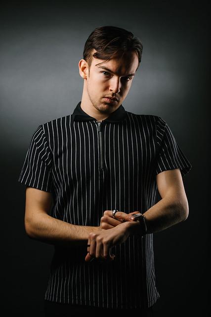 Cometan Adjusts His Timepiece