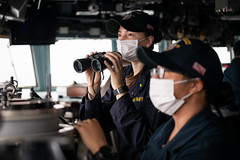 TAIWAN STRAIT (Nov. 20, 2020) Ensign Antonia Vinci, from St. Petersburg, Fla., scans the horizon for contacts on the bridge of the guided-missile destroyer USS Barry (DDG 62) as the ship conducts routine underway operations in the Taiwan Strait. Barry is assigned to Destroyer Squadron (DESRON) 15, the Navy's largest forward-deployed DESRON and the U.S. 7th Fleet's principal surface force, forward-deployed to the U.S. 7th Fleet area of operations in support of a free and open Indo-Pacific. (U.S. Navy photo by Lieutenant Junior Grade Samuel Hardgrove)