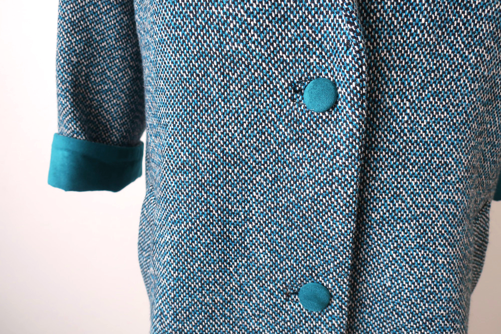 Teal coat buttons