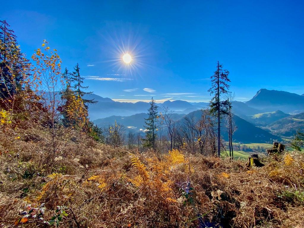 Landscape basking in the autumn sun seen from Nußlberg mountain near Kiefersfelden in Bavaria, Germany