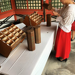 pulling out an omikuji (fortune stick)